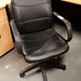 Black leatherette swivel chair