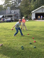 A heated Bocce Ball match. Here Bobby Barnes and Linda Brooks get a leg up on Mike Wienold and his son Tom (not pictured).