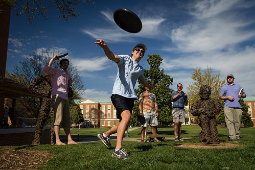 Student throws frisbee