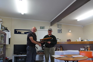 Ian Wallace being presented the Capsize trophy by Will Perry | by PLSC (Panmure Lagoon Sailing Club)