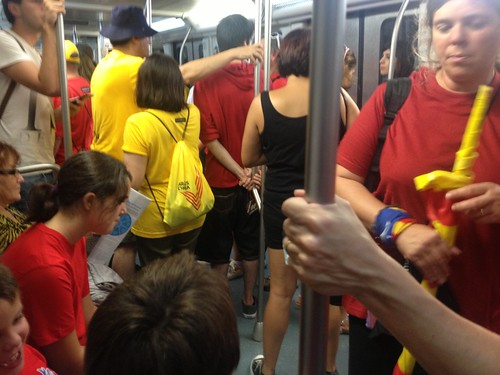 Lots of red and yellow t-shirts in the metro | by Liz Castro