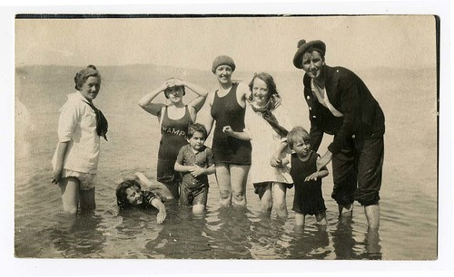 [Man, women and children wading in water] | by California Historical Society Digital Collection