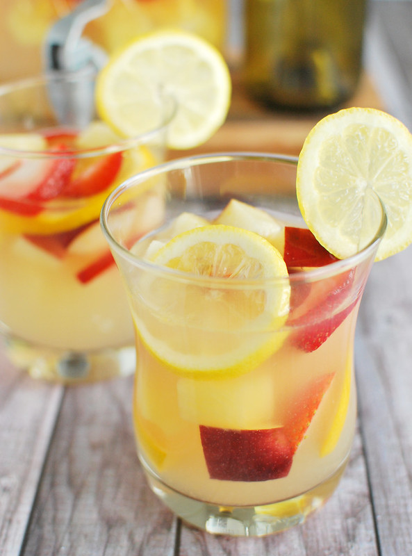 Pineapple Lemonade Sangria - the ultimate summer drink recipe! White wine, lemonade, and rum with tons of fresh fruit mixed in. It can be made ahead so it is perfect if you are prepping for a party!