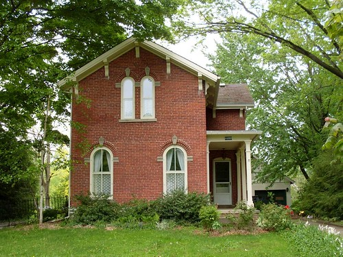 wood flowers ohio red house building brick home rain weather architecture style structure molding domestic porch residence posts italianate archedwindows ashtabulacounty austinburg lowpitchedroof projectingeaves decoratedbrackets