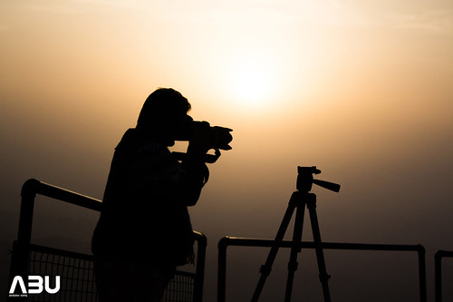 A silhouette of a photographer on the Gorakh top