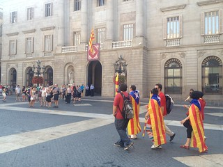 People walking across Plaça Sant Jaume about 9:45am, Sept 11 | by Liz Castro