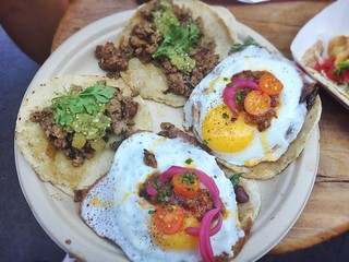 1. Wild boar taco with roasted Anaheim chiles, 2. Local beans & fried egg taco with fava beans, fresh pigeon peas, sunburst tomatoes, pickled onions, chile del valle, & chives | by T.Tseng