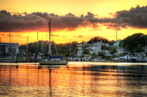 ocean sunset orange sailboat southport