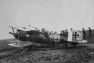 Allied troops examining captured Albatros aircraft of the Luftwaffe, France / Les troupes alliées examinant un avion Albatros de la Luftwaffe qu'ils ont capturé, en France