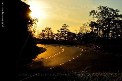 road travel light sunset vacation cliff mountains silhouette backlight virginia nationalpark glare unitedstates roadtrip va mysterious sunburst curve shenandoah elkton starburst skylinedrive pavedroad
