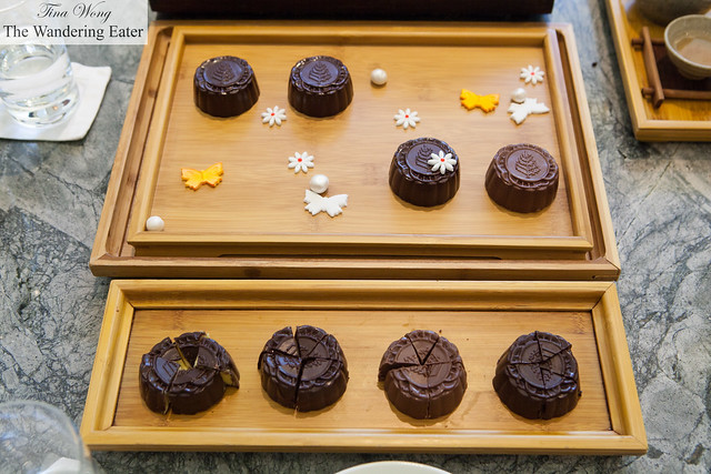 Four Season Beijing's Limited Edition Noir Or mooncakes - Medium sized chocolates with various ganaches in the shape of mooncakes with Four Season's logo