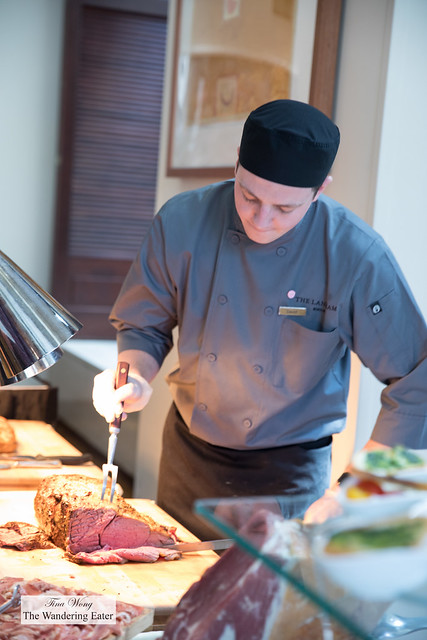 Cook slicing the prime rib