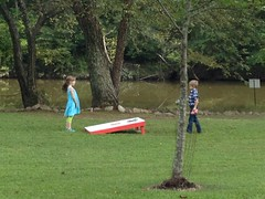 Kids playing corn hole at the club social.
