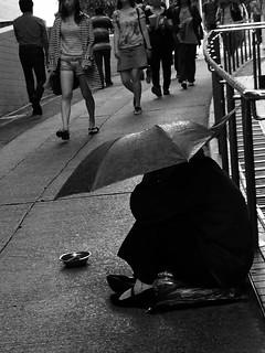 Begging in the rain.