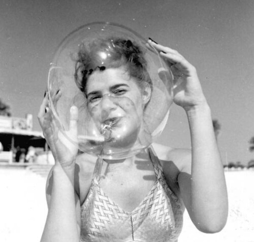 Leatrice Jackson blows a bubble balloon - Panama City Beach | by State Library and Archives of Florida