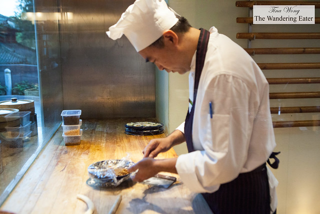 Chef wrapping dumplings at Made in China's breakfast buffet