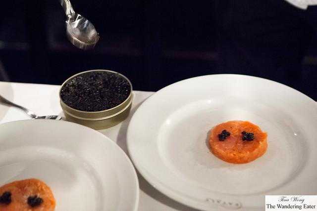 Large container of Osetra caviar meets salmon tartare