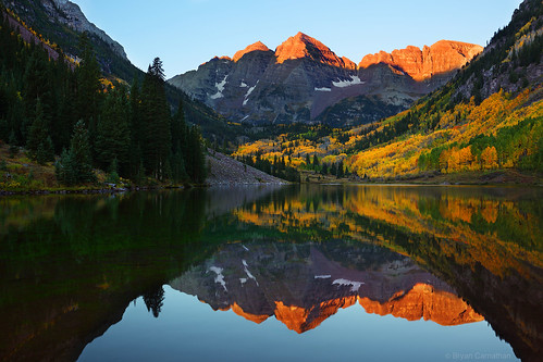 Striking Gold: Maroon Bells Peaks Reflecting in Maroon Lake | by Bryan Carnathan