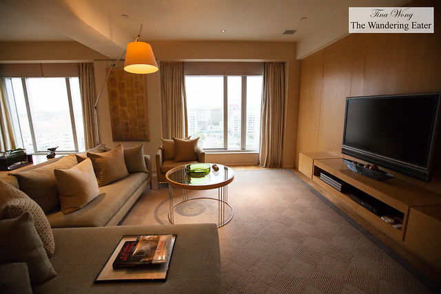 Living room area with a large screen TV at the Grand Deluxe King room