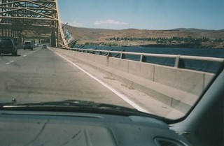Photo of the I-90 Vantage Bridge lane edge taken from a car windshield, 2003.  Ledge is barely wide enough to ride on and one's panniers can often bump the side.  Then there is the tiny piece of roadway between fog line and ledge. | by theslowlane