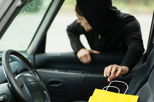 thief stealing shopping bag from the car | by findcollections