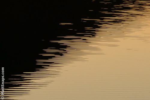 sunset sea orange black water lines