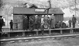Group including Indian immigrants on the platform of a Canadian Pacific Railway station, Frank, Alberta, ca. 1903 / Groupe comprenant des immigrés indiens sur la plateforme d'une station du Chemin de fer Canadien Pacifique, vers 1903, à Frank (Albert