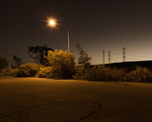 longexposure nightphotography urban night dusk streetlamp australia sa pylons carpark bushes southaustralia steetlight portadelaide tiretreadmarks