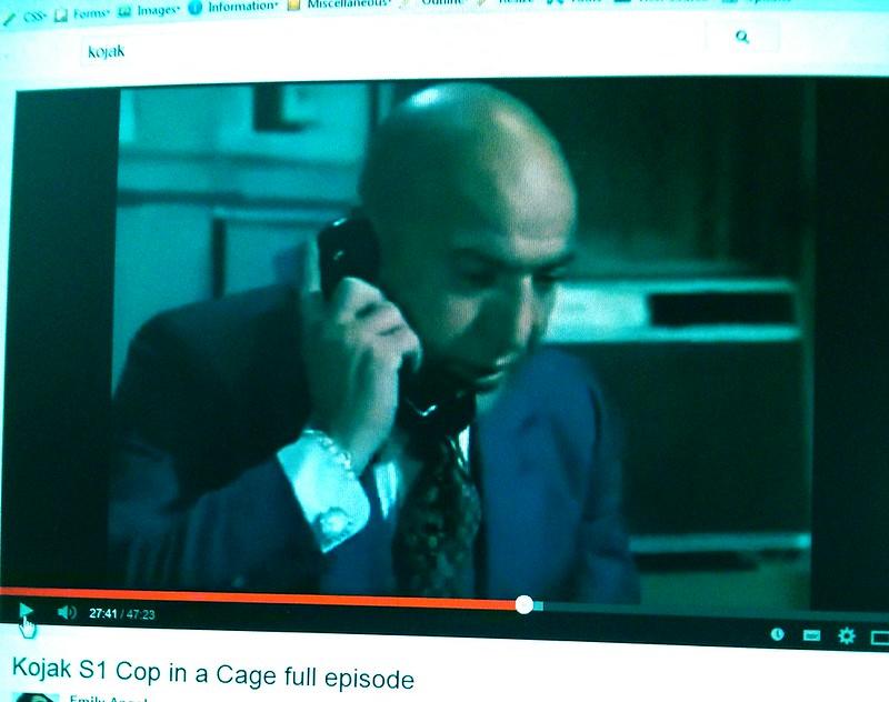 Watching YouTube all alone, watching Kojak on my phone