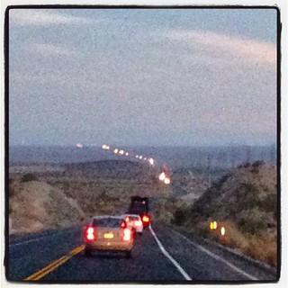 A line of oncoming headlights as far as the eye can see. CA Route 395, Mojave Desert. #airstream #airstreamdc2cali #vintageairstream #vintage #liveriveted