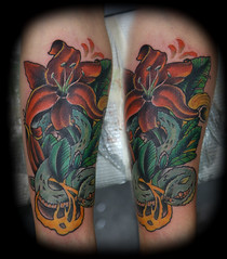Flower and snake tattoo