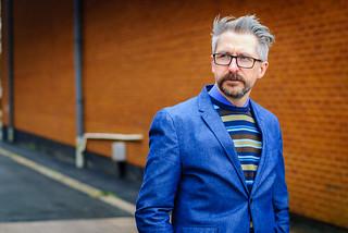 Smart menswear: Blue blazer \ striped sweater \ grey dress trousers \ brown brogues   Silver Londoner, over 40 style   by silverlondoner