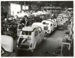 In foreground is Henry Jenaro Nelle, from Naples, an assembler at the Fiats Assembly Works.