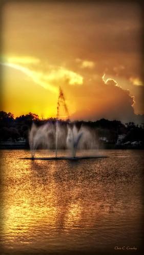 ongoldenpond sunset lake fountain scenic reflection clouds landscape golden reedcanalpark southdaytonaflorida