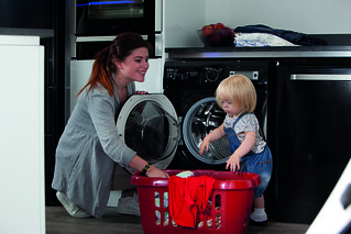 Woman doing laundry with child | by CDAappliances