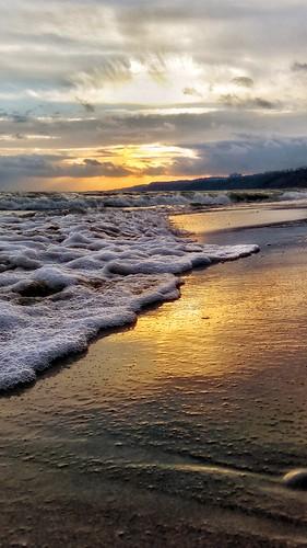 sand urbanoasis clouds sunrise greatlake waves surfsup scarborough ontario canadianbeach