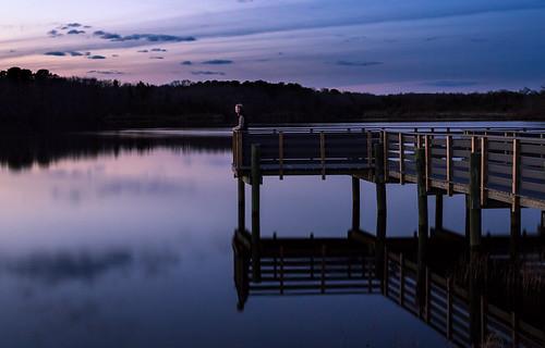 helmettapond person lakemarguerite dock lake longexposure bluehour dusk helmetta newjersey unitedstates us sunset landscape ll