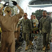Members of the 332nd Expeditionary Medical Group Contingency Aeromedical Staging Facility carry a trauma patient onto a C-17 Globemaster III at Balad Air Base, Iraq, on April 22. Patients on the aircraft are positioned according to the severity of their injuries. Keeping patients organized this way helps flight doctors and nurses triage their care. (U.S. Air Force photo/ Staff Sgt. Julianne Showalter)