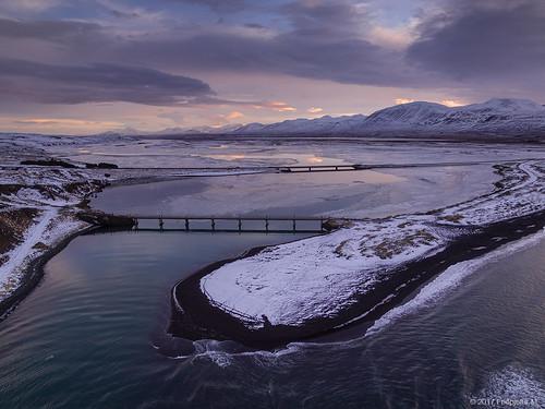 sveitarfélagiðskagafjörður iceland friðþjófurm djiphantom landscape winter snow clouds sunset river héraðsvötn skagafjörður skagafjordur bridge bridges mountains outdoor arialphotography