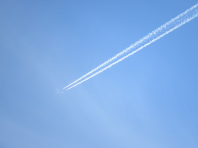 airplane with contrail