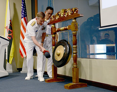 Rear Adm. Charlie Williams, commander of Task Force 73, strikes a ceremonial gong during the opening ceremony of CARAT Brunei, Nov. 10. (U.S. Navy/MC1 Jay C. Pugh)