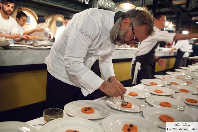 Massimo Bottura plating the salmon with Osetra caviar