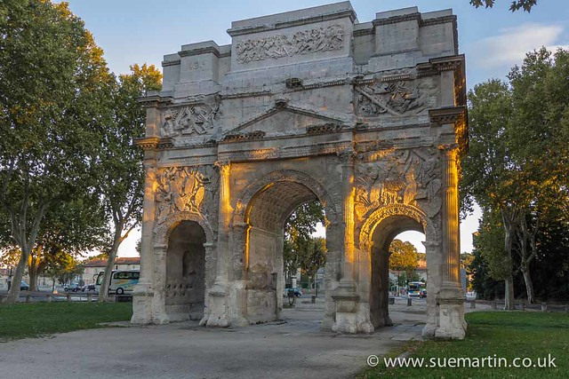 Arc de triomphe d'Orange in evening sunlight