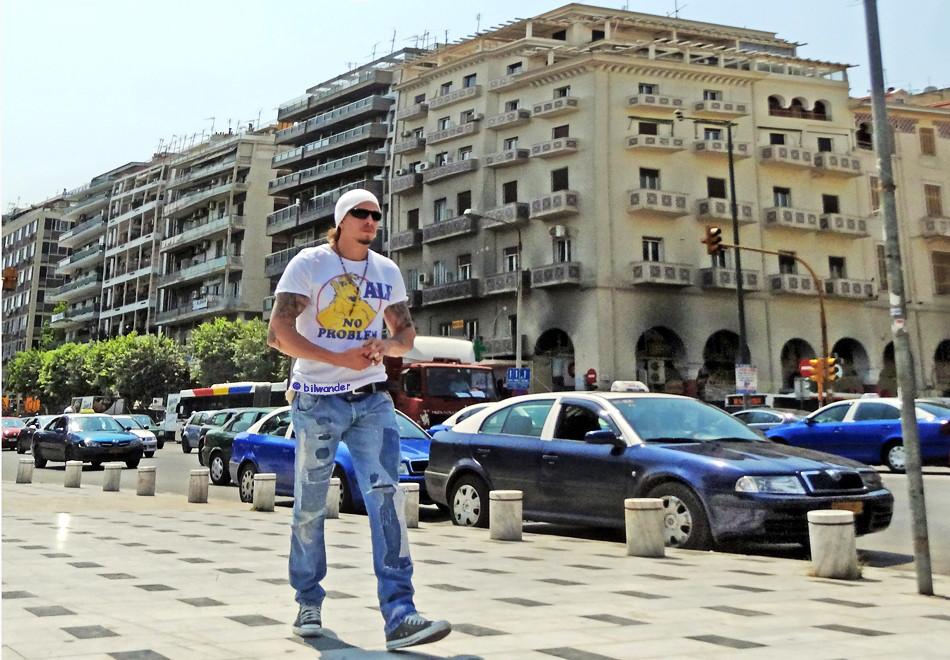 Greece, Macedonia, Thessaloniki, big guy with tattoos, bonnet cap, shades & NO PROBLEM t-shirt