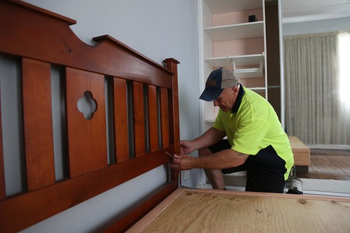 Photo of Removalist taking apart bed for moving | by sunset_removals