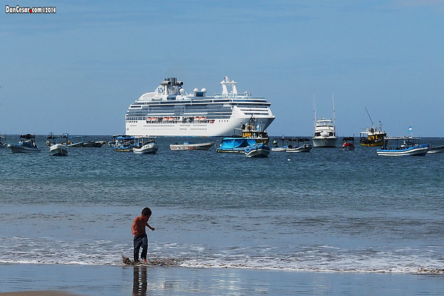 Boy playing with the Princess Island in the background at the port of San Juan del Sur, Nicaragua