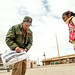 """Civilian QF-4E Pilot/Controller Lt. Col. (Ret) Jim """"WAM"""" Harkins, signs a poster for F-4 fans, after exiting his McDonnell Douglas F-4 Phantom II for last time on the final military flight of the storied aircraft at Holloman AFB, N.M., Dec. 21, 2016. The final variant of the Phantom II was the QF-4 unmanned aerial targets flown by the 82nd Aerial Target Squadron Detachment 1 at Holloman AFB. The ceremonial flight was Harkins last in a cockpit for the Air Force; he will now serve as a ground controller for the QF-4's replacement, the QF-16. The F-4 Phantom II entered the U.S. Air Force inventory in 1963 and was the primary multi-role aircraft in the USAF throughout the 1960s and 1970s. The F-4 flew bombing, combat air patrol, fighter escort, reconnaissance and the famous Wild Weasel anti-aircraft missile suppression missions.  (U.S. Air Force photo by J.M. Eddins Jr.)"""