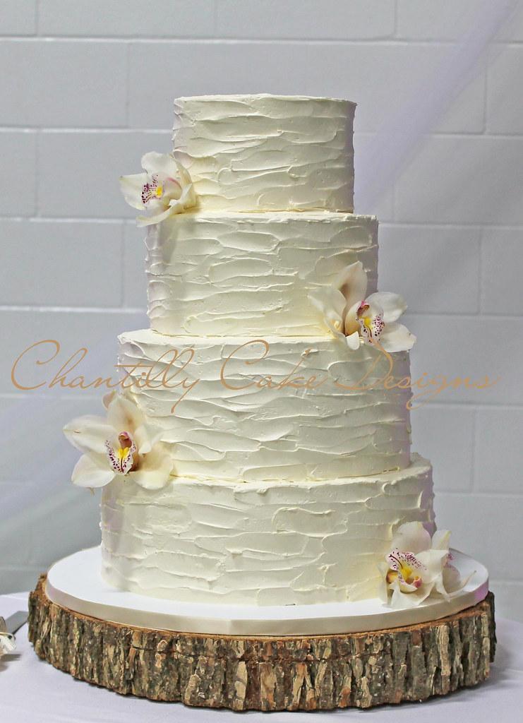 Buttercream wedding cake with sugarpaste flowers #