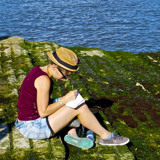 Girl taking notes at the river border | by pedrosimoes7