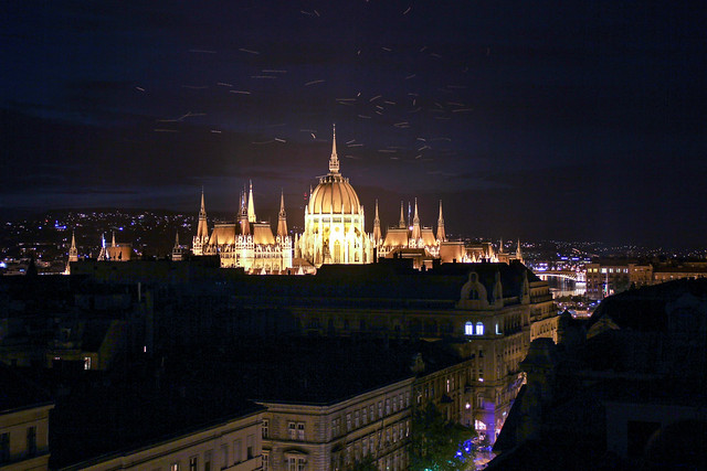 Budapest - the illuminated Parliament building with fireflys
